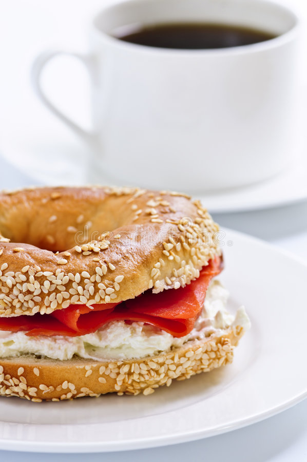 Smoked salmon bagel and coffee royalty free stock image