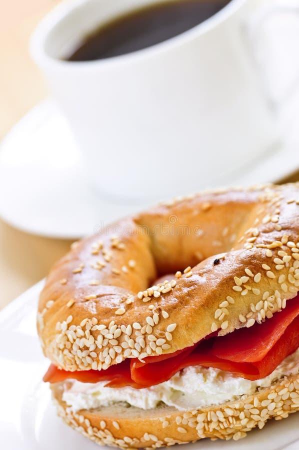 Smoked salmon bagel and coffee stock image