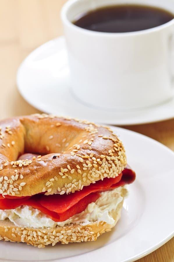 Smoked salmon bagel and coffee royalty free stock photos