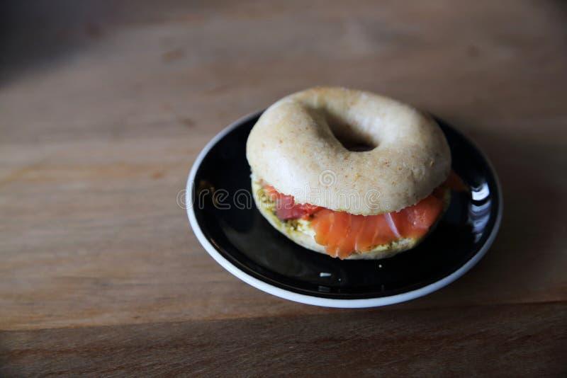 Smoked salmon bagel royalty free stock photo