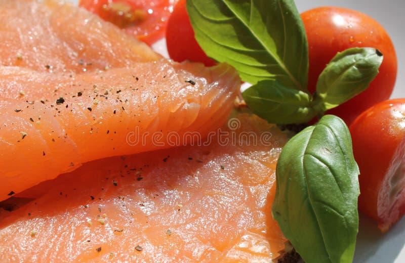 Smoked salmon basil and tomatoes stock image