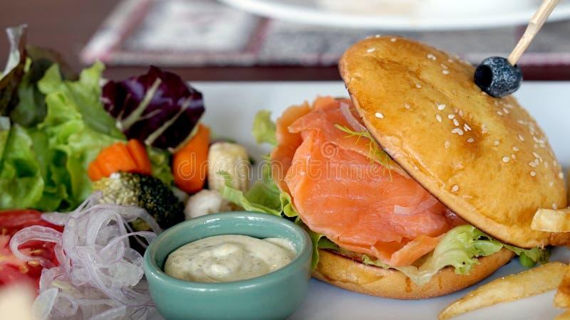 Smoked salmon burger stock photography