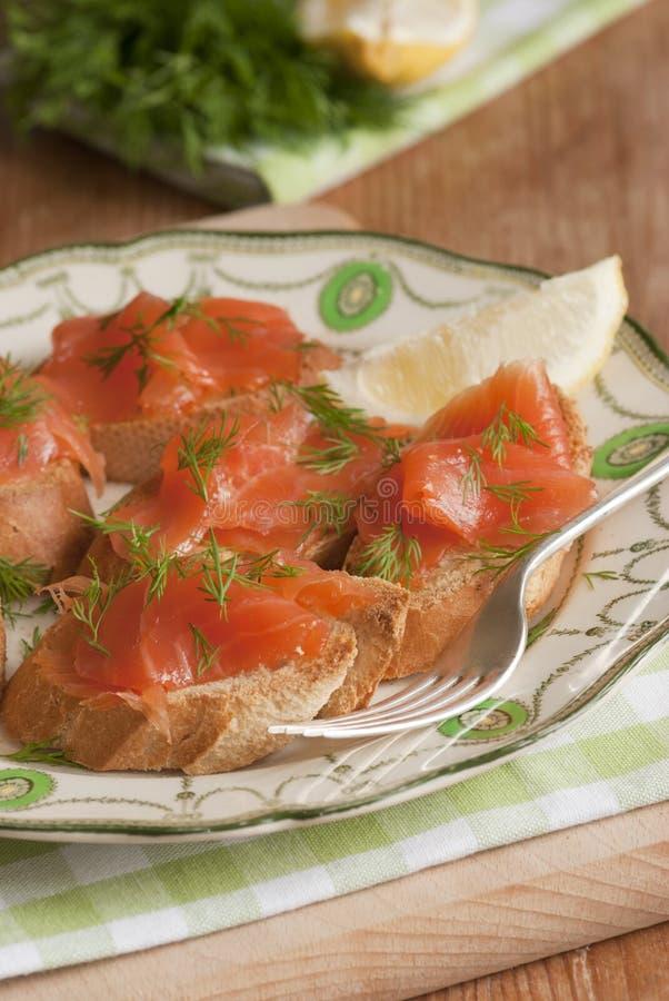 Smoked salmon canapes royalty free stock image