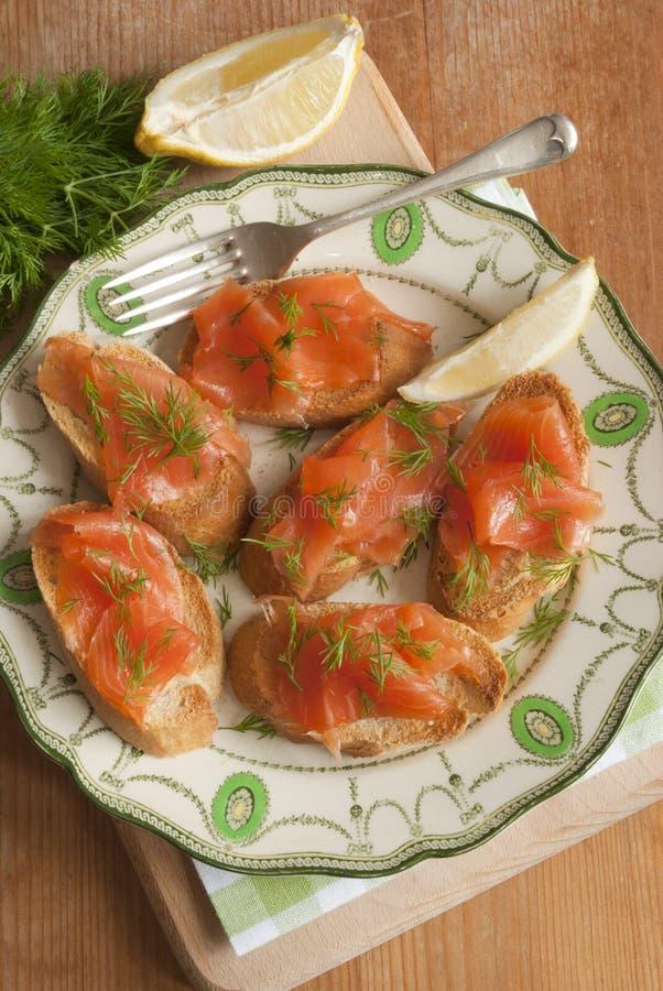 Smoked salmon canapes stock photo