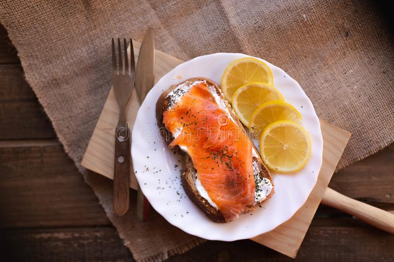 Smoked salmon with cheese toasted bread lemon and yogurt dip. Smoked salmon with toasted bread lemon and yogurt dip for breakfast royalty free stock photo