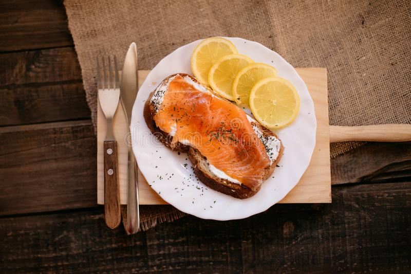 Smoked salmon with cheese toasted bread lemon and yogurt dip. Smoked salmon with toasted bread lemon and yogurt dip for breakfast stock photo