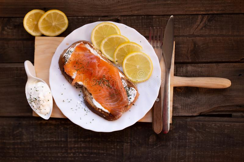 Smoked salmon with cheese toasted bread lemon and yogurt dip. Smoked salmon with toasted bread lemon and yogurt dip for breakfast stock photography