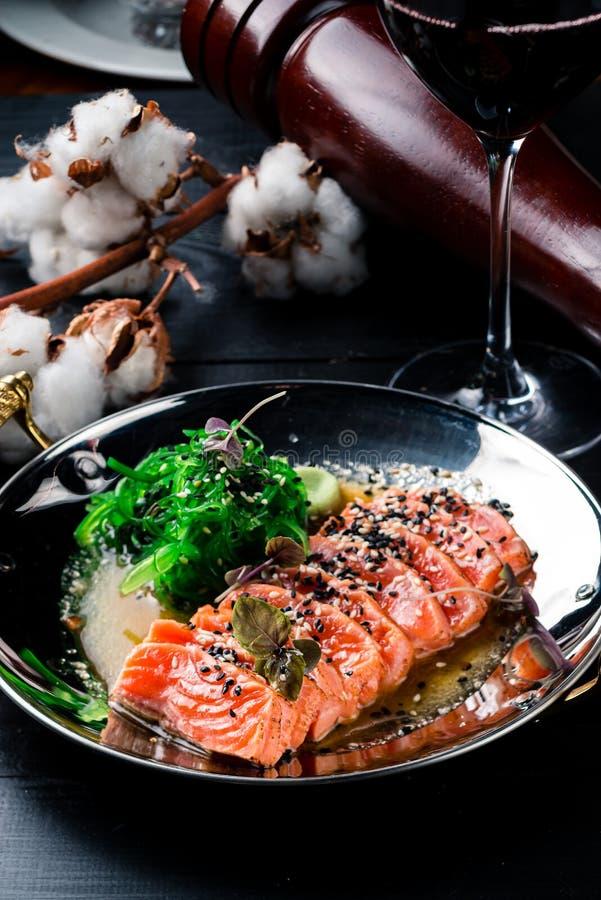 Smoked salmon with Chuka salad stock images