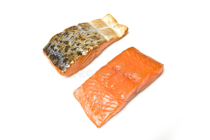 Smoked Salmon Fillets. A view of smoked salmon fillets, isolated on a white studio background royalty free stock photography