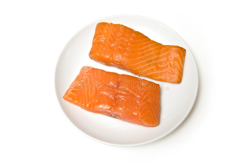 Smoked salmon fillets. Two smoked salmon fillets on plate, isolated on white background royalty free stock images
