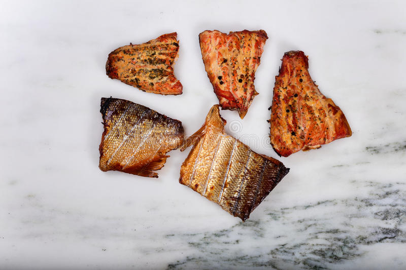 Smoked salmon fillets on marble stone countertop stock photo