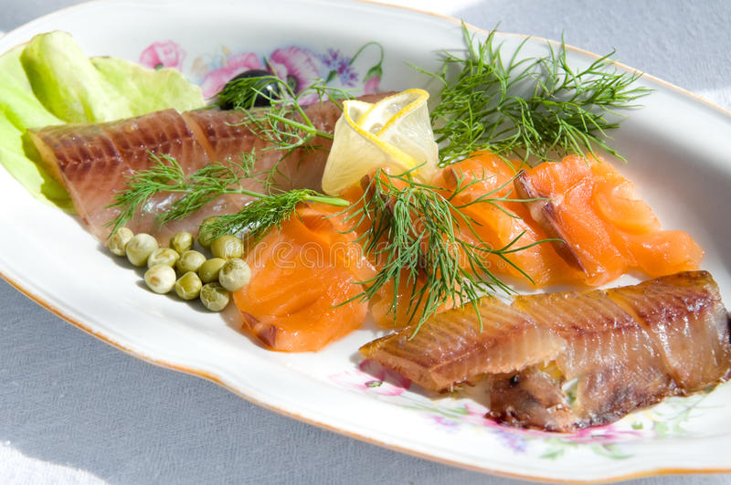 Smoked salmon and herring royalty free stock images