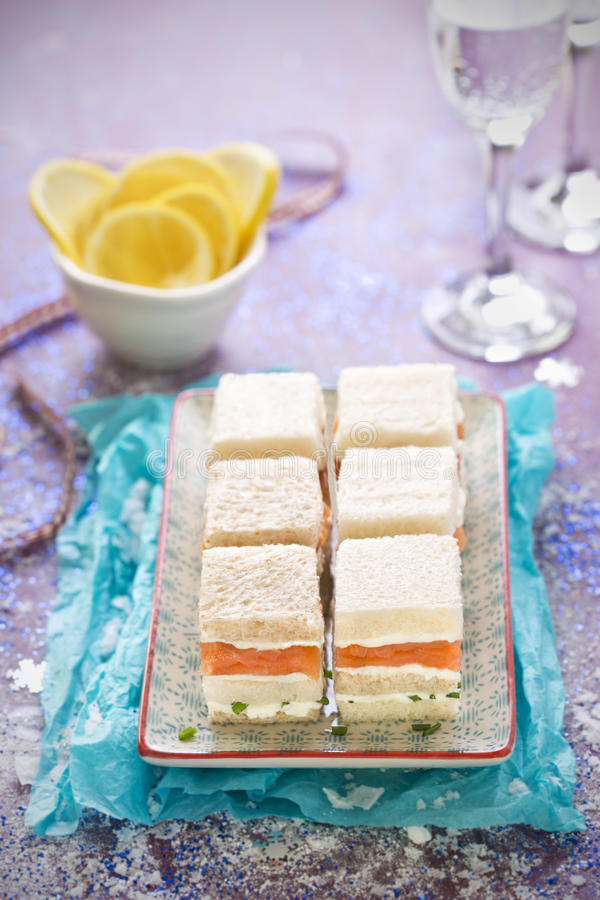 Smoked salmon layered sandwiches stock photography