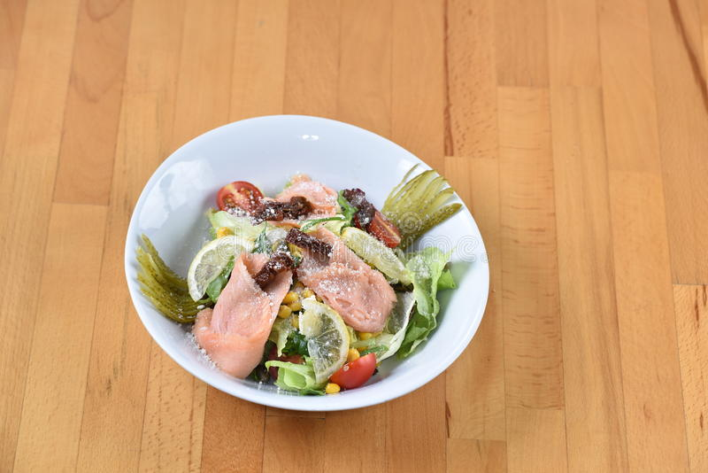 Smoked Salmon Salad. Mixed with salad and pickles royalty free stock photography
