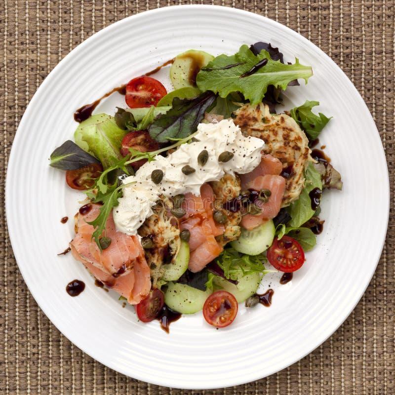 Smoked Salmon Salad with Potato Rosti royalty free stock image