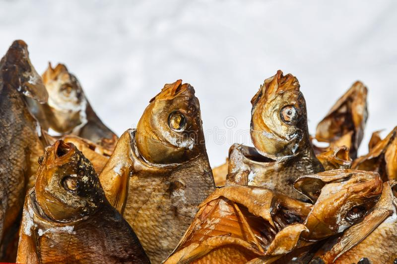 Smoked salty fish at the market in winter stock image
