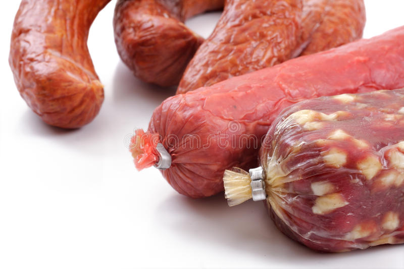 Smoked sausage over white stock image