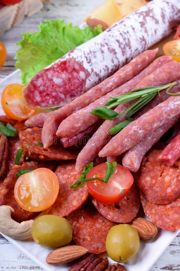 Smoked sausages assortment on the white tray royalty free stock image