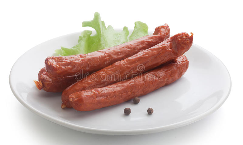 Smoked sausages with lettuce (Jagdwurst) royalty free stock image