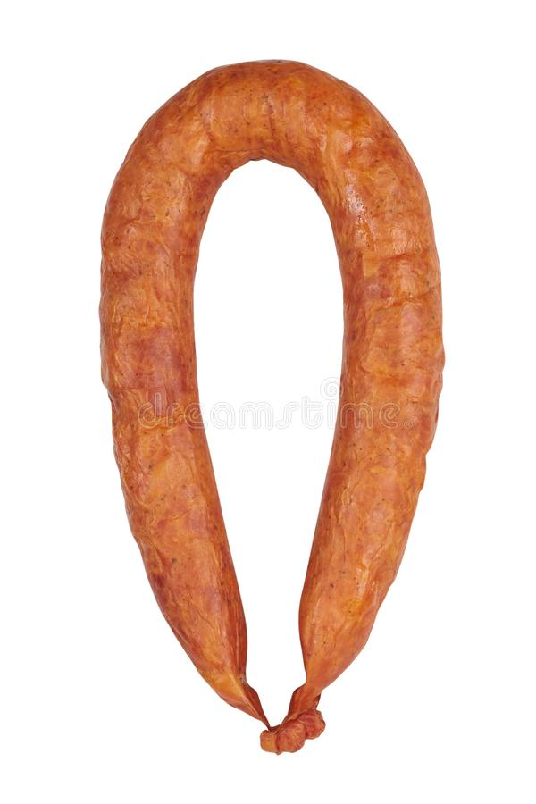 Smoked sausages. One sausage is cut. Isolated on a white background royalty free stock photos