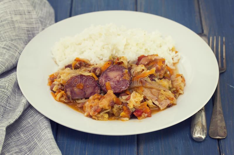 Smoked sausages with vegetables and boiled rice stock images