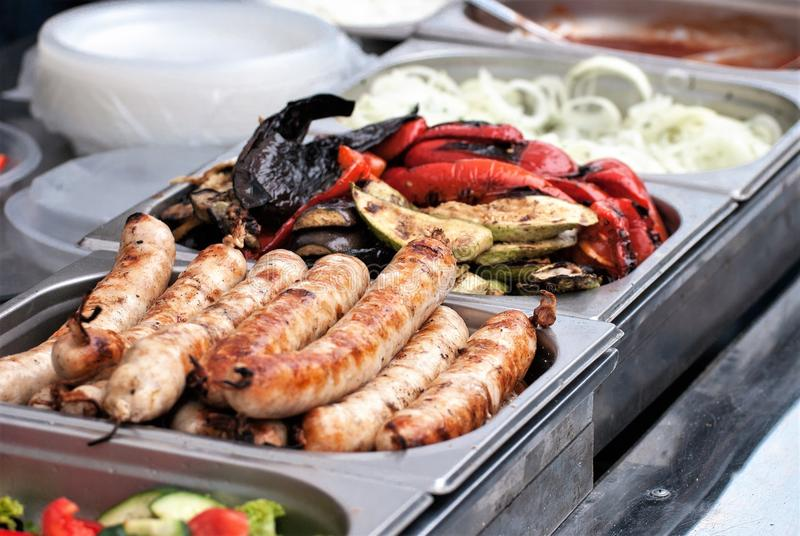 Smoked vegetables, sausages, grilled sausages royalty free stock photos