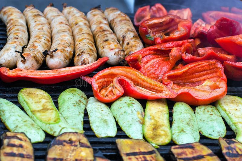Fried, on the grill, vegetable and meat sausages. stock photos