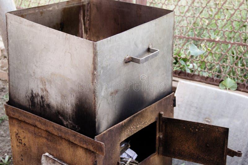 Smokehouse grill for hot smoking fish at home stock photos
