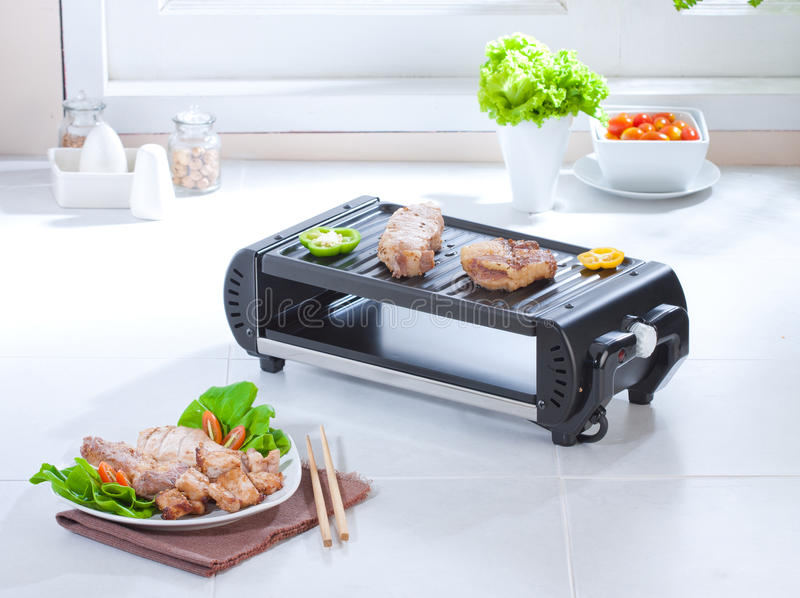 Smokeless steak or barbecue stove stock photography