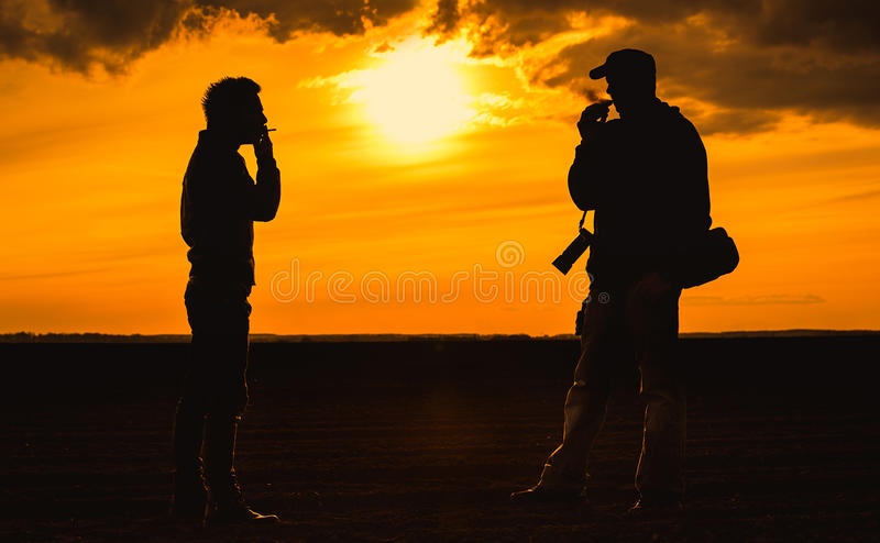 Smokers silhouette the sunset royalty free stock photos