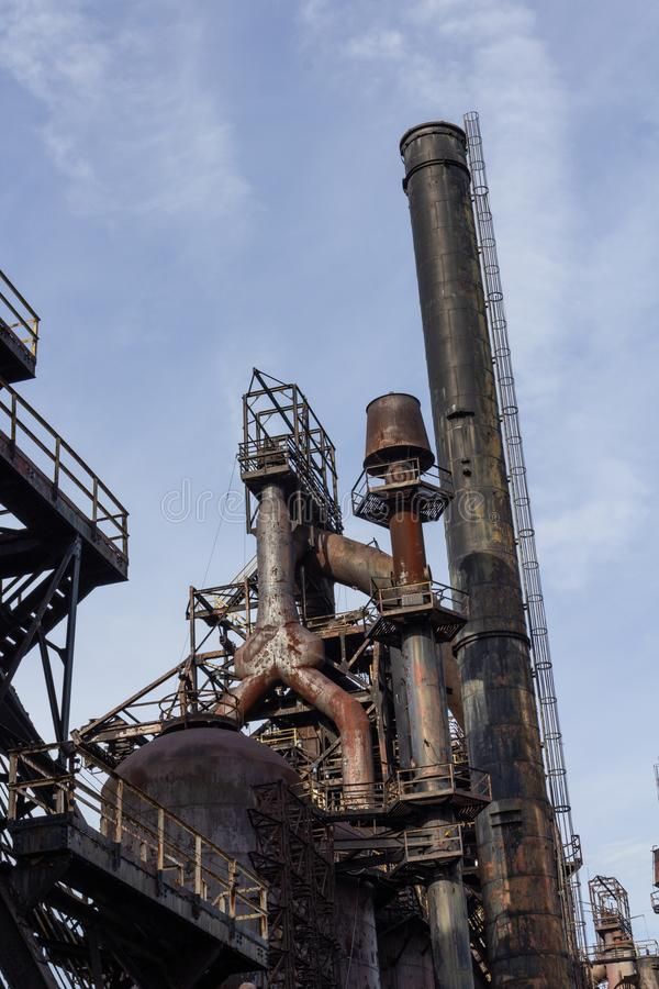 Smokestack and blast furnace, steel industry complex, industrial textures. Vertical aspect royalty free stock photos