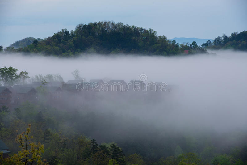 Smokey Mountains Cabins. Foggy view of cabins of a cloudy early morning in the Great Smokey Mountains, Tennessee royalty free stock photography