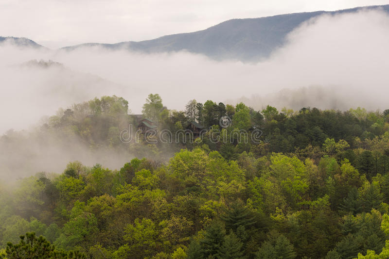Smokey Mountains Cabins. Foggy view of cabins on a cloudy early morning in the Great Smokey Mountains, Tennessee royalty free stock images