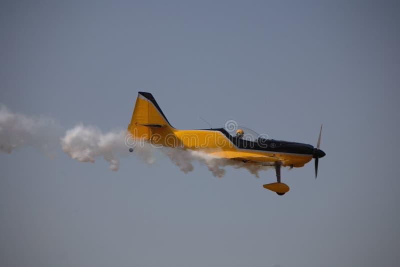 Smoking aircraft. Smoking single engine aircraft royalty free stock image