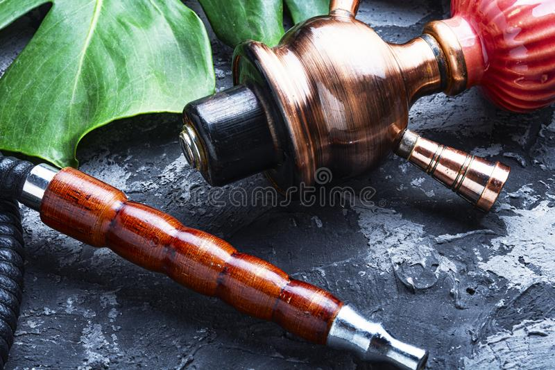 Smoking arab hookah. Details of the eastern kalian.Hookah with tropical flavor.Smoking tropical tobacco royalty free stock photography