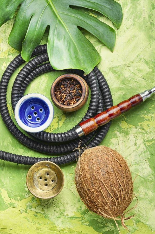 Smoking arab hookah. Details of the eastern kalian.Hookah with tropical flavor.Smoking tropical tobacco royalty free stock photos