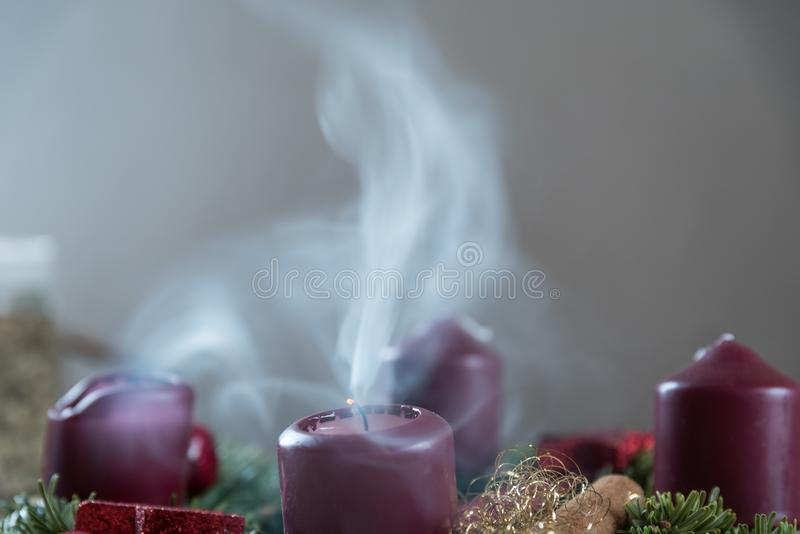 Smoking candle on Advent wreath stock photography