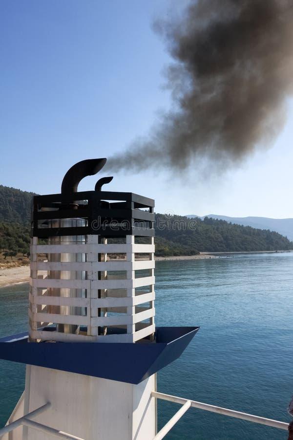 Smoking chimney. Of the boat, Halkidiki, Greece stock image