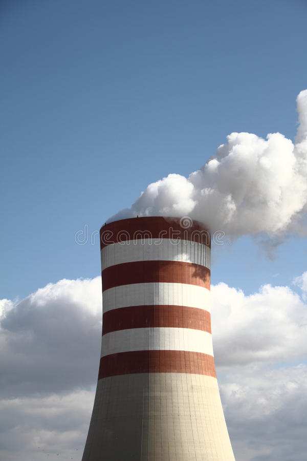 Smoking chimney. Of a power plant royalty free stock photo