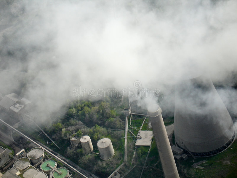 Smoking chimney, aerial view. Smoking chimney of a power plant, aerial view royalty free stock images