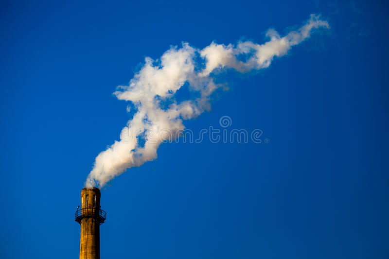 The Smoking Chimney. In Beijing, this is why the air pollution more serious than before royalty free stock photo