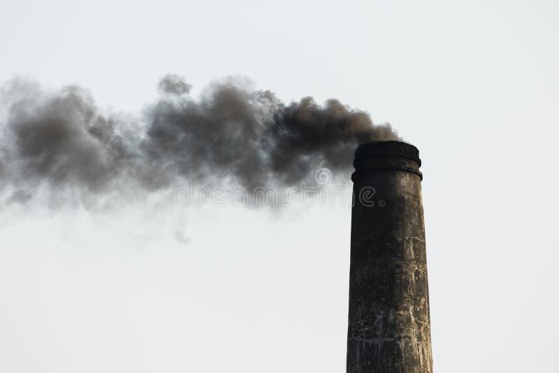 Smoking chimney of a brick factory in Bangladesh. Asia royalty free stock photo