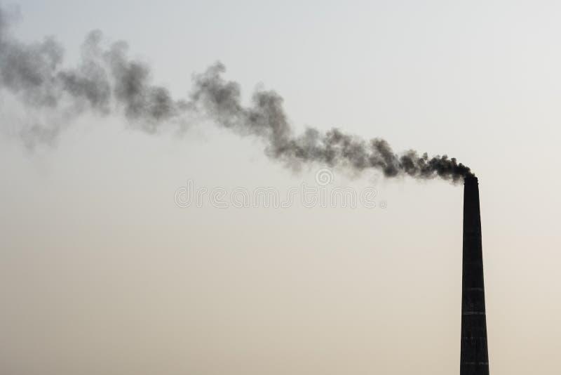 Smoking chimney of a brick factory in Bangladesh. Asia stock image
