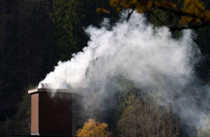 Smoking chimney of a house royalty free stock photos