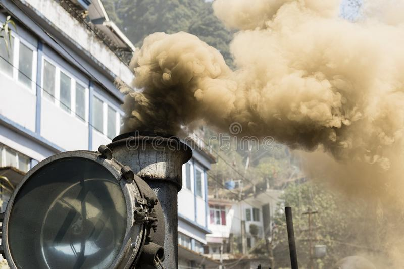 Smoking chimney with old lamp of the steam locomotive toy train royalty free stock image