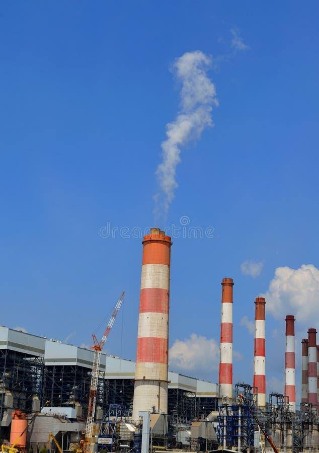 Smoking chimney pollution air. The Smoking chimney pollution air royalty free stock photo