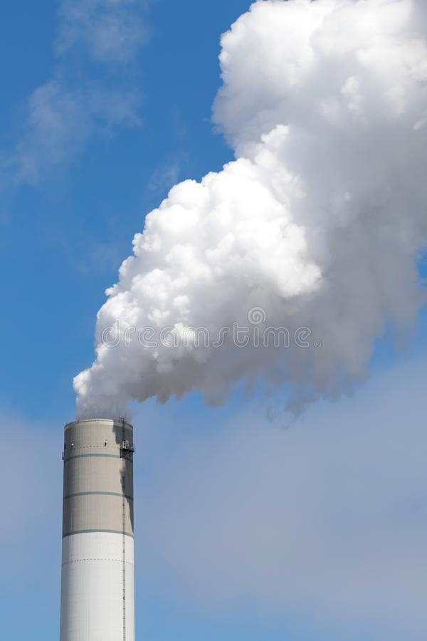 Smoking chimney. Of a coal-fired power plant stock photography