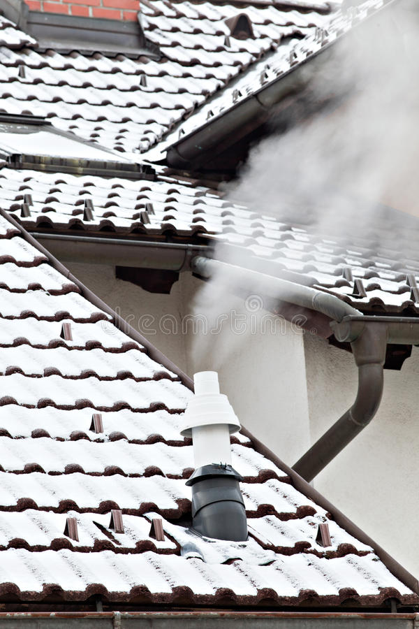 Smoking chimney. On a winter day royalty free stock images