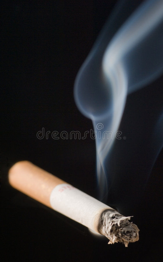 A smoking Cigarette royalty free stock photography