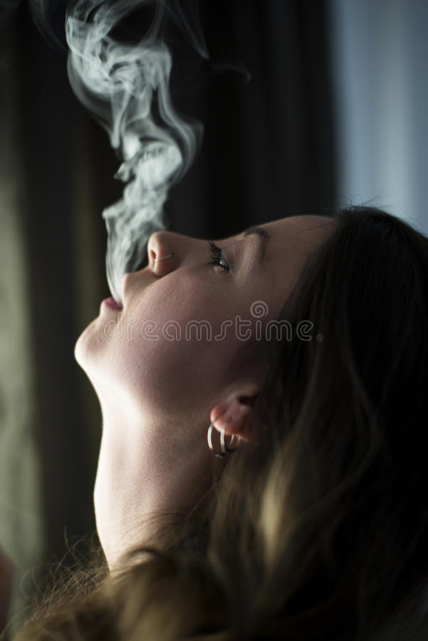 Smoking cute girl. royalty free stock photography